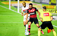 SAO PAULO, BRAZIL - FEBRUARY 25: Mauricio Isla of CR Flamengo competes for the ball with Bruno Alves of Sao Paulo FC ,during the Brasileirao Serie A 2020 match between Sao Paulo FC and CR Flamengo at Morumbi Stadium on February 25, 2021 in Sao Paulo, Brazil. (Photo by MB Media/BPA)