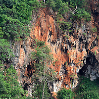 Tourists standing on the edge of Railay Viewpoint in Krabi.