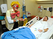 """PRICE CHAMBERS / NEWS&GUIDE<br /> Michael Klein-Katz spreads smiles through St. John's Medical Center on Thursday as his alter-ego Matoki the Clown visits with patients and staff. Matoki means """"Sweetie"""" in Hebrew, the rabbi from Jerusalem said."""
