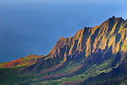 Alealau, a 3,875-foot mountain, towers over the Kalalau Valley below on Kauai's rugged Na Pali coast.