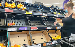 © Licensed to London News Pictures. 20/09/2020. London, UK. A shopper wearing a face covering standing near empty crates of oranges in a Sainsbury's supermarket in London, as essential items start to run out, amid a possible second lockdown due to a rise in COVID-19  cases. Photo credit: Dinendra Haria/LNP