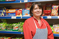 Polish Shop owner standing on shop floor,