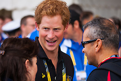 Queen Elizabeth Olympic Park, London. September 13th 2014. Prince Harry chats with competitors as wounded servicemen and women from 13 different countries compete for sporting glory during the cycling competition at the Invictus Games.