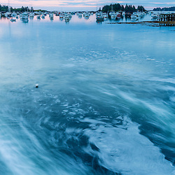 The rushing outgoing tide in the harbor in Vinalhaven, Maine.