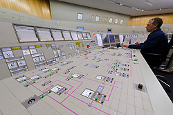 An RWE employee works in the control room at the RWE nuclear power plant, in Lingen, Germany, on Tuesday, Sept. 6, 2011. (Photo © Jock Fistick)