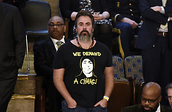 """Manuel Oliver, wearing a T-shirt with his son Joaquin """"Guac"""" Oliver attends President Trump 's State of the Union address to a joint session of the U.S. Congress on Capitol Hill February 5, 2019 in Washington, DC. DC.Photo by Olivier Douliery/ABACAPRESS.COM"""