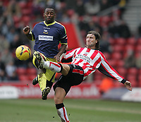 Photo: Lee Earle.<br /> Southampton v Derby County. Coca Cola Championship. 04/02/2006. Saint's Kamil Kosowski (R) goes in high on Michael Johnson.