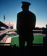 "CHICAGO, IL-UNDATED:  An Andy Frain usher looks on during a baseball game at ""Old"" Comiskey Park, home of the Chicago White Sox from 1910 thru 1990.  It was demolished in 1991.  (Photo by Ron Vesely)"
