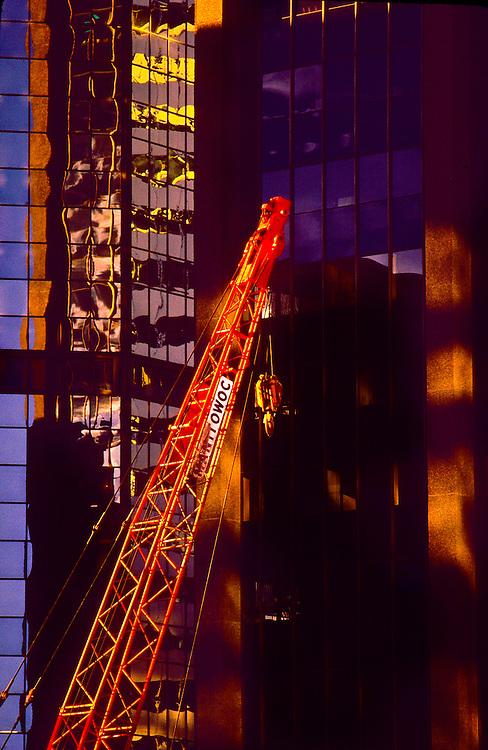 red construction crane, building reflections, downtown Denver, Colorado