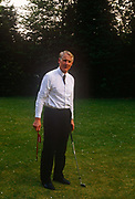 A portrait of British senior civil servant, Sir Robin Butler while practicing putting in the summer of 1989, at the Civil Service College at Sunningdale, England. Butler had a high-profile career in the civil service from 1961 to 1998, serving as Private Secretary to five Prime Ministers. He was Secretary of the Cabinet and Head of the Home Civil Service from 1988 to 1998. Frederick Edward Robin Butler, Baron Butler of Brockwell, KG, GCB, CVO, PC b1938 is a retired British civil servant, now sitting in the House of Lords as a crossbencher.