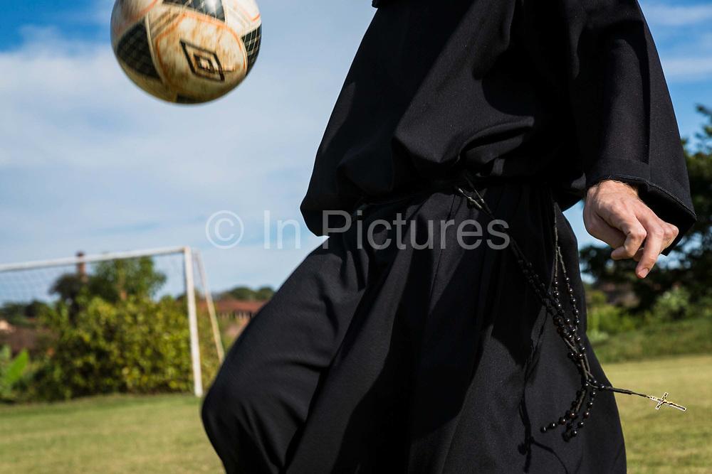 A priest from Santo Tomas de Vilanova seminary, practices his skills on the pitch, Ourinhos, Brazil