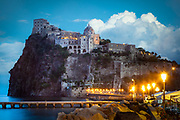 Castello Aragonese is a medieval castle next to Ischia (one of the Phlegraean Islands), at the northern end of the Gulf of Naples, Italy. The castle stands on a volcanic rocky islet that connects to the larger island of Ischia by a causeway (Ponte Aragonese). Castello Aragonese is the most impressive historical monument in Ischia, built by Hiero I of Syracuse in 474 BC.