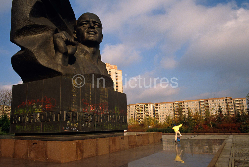"""A young skateboarder leaps into the air beneath the huge memorial to the German Communist leader Ernst Thalmann, the leader of the Communist Party of Germany (KPD) during much of the Weimar Republic. He was arrested by the Gestapo in 1933 and held in solitary confinement for eleven years, before being shot in Buchenwald on Adolf Hitler's orders in 1944. The Ernst Thälmann Pioneer Organisation, consisting of the Young Pioneers and the Thälmann Pioneers, was a youth scouting-styled organisation of schoolchildren aged 6 to 14, in East Germany. Its motto was"""" """"Für Frieden und Sozialismus seid bereit – Immer bereit"""" (""""For peace and socialism be ready - always ready"""") but the Pioneers were disbanded in 1989 after early protests here in Leipzig at the same time as the Berlin Wall and the Socialist state's fall."""