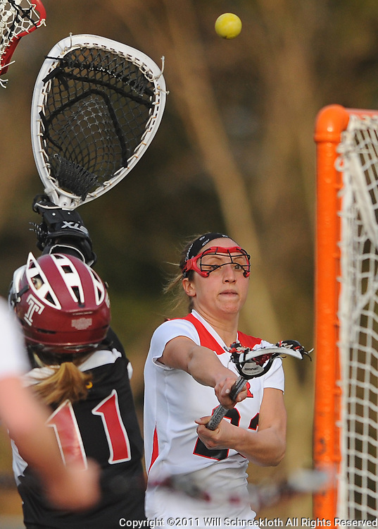 Rutgers senior attacker Lindsey Watts shoots high over Temple senior goalie Tess Bishop. Temple defeated Rutgers 12-11 in NCAA women's college lacrosse at the Rutgers Turf Field in Piscataway, N.J.