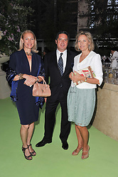 Left to right, KATE RAVERY, PASCAL RAVERY and CARLA BAMBERGER at a dinner hosted by Cartier in celebration of the Chelsea Flower Show held at Battersea Power Station, 188 Kirtling Street, London SW8 on 23rd May 2011.
