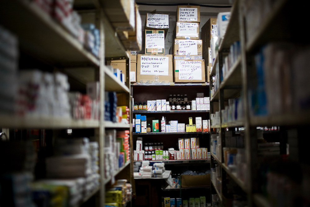 The drug stock room at the Maria Leonza pharmacy  in Petare, one of the largest and most dangerous slums of Caracas.  Pfizer is trying to increase their market share in the slums and are targeting clinics, hospitals and pharmacies, sending sales representatives to the far reaches of the slum.