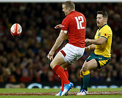 Bernard Foley of Australia threads the ball past Hadleigh Parkes of Wales<br /> <br /> Photographer Simon King/Replay Images<br /> <br /> Under Armour Series - Wales v Australia - Saturday 10th November 2018 - Principality Stadium - Cardiff<br /> <br /> World Copyright © Replay Images . All rights reserved. info@replayimages.co.uk - http://replayimages.co.uk