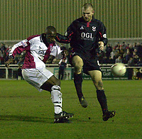 Picture: Raymond Field<br /><br /><br />Woking F.C v Kidderminster Harriers FA second round<br /><br />06/12/2003<br /><br /><br />Davis Haule trys to stop Danny Williams