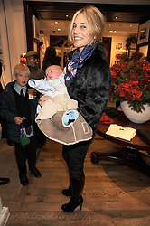 KIM HERSOV and her son ETHAM at the launch of 'A Better World' a single by Laura Comfort held at the Ralph Lauren children's store, Old Brompton Road, London on 2nd December 2008.