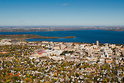 An aerial view of Madison, Wisconsin,  the University of Wisconsin-Madison's Camp Randall Stadium, surrounded by Lakes Mendota (above) and Picnic Point.