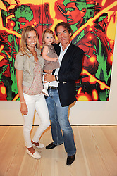 TIM & MALIN JEFFERIES and their daughter COCO at the BRIC art sale preview (Brazil, Russia, India & China, the acronym BRIC here refers to the burgeoning contemporary art practices within these four countries.) organised by Phillips de Pury & Company at The Saatchi Gallery, London on 17th April 2010.