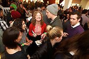 New York, NY - March 18, 2015: Guests take a break from the snacks and drinks at Good Cider, a food and hard cider tasting hosted by Edible Manhattan in Tribeca. <br /> <br /> CREDIT: Clay Williams for Edible Manhattan.<br /> <br /> © Clay Williams / claywilliamsphoto.com