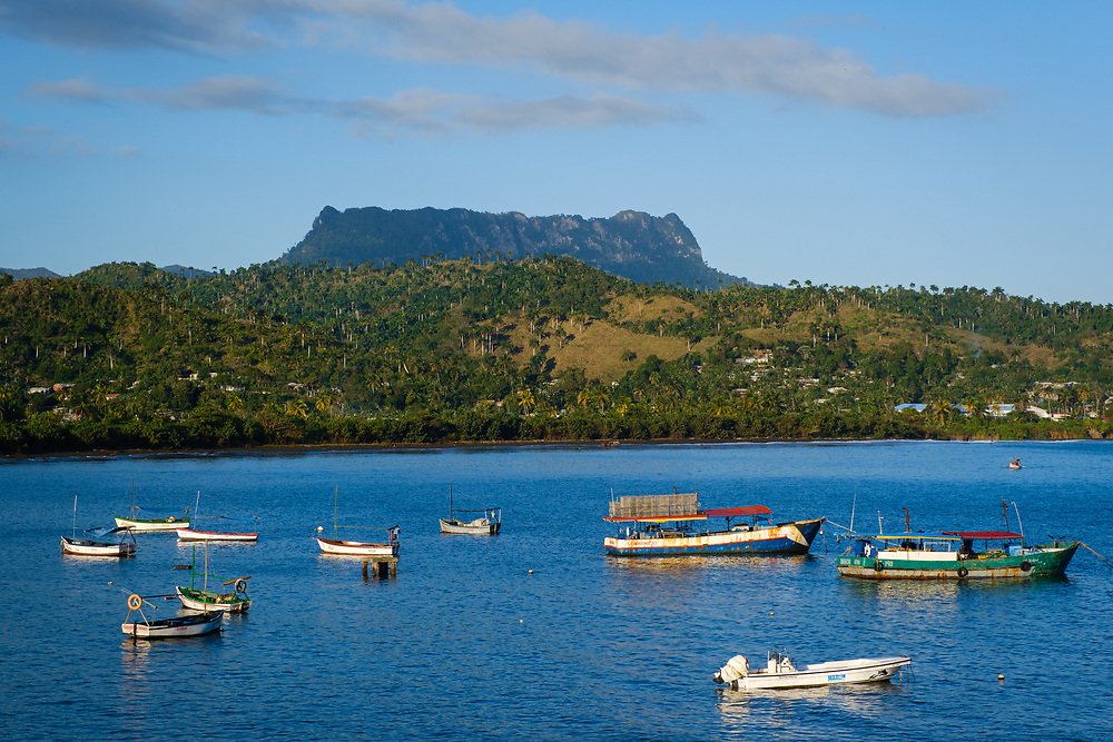 BARACOA, CUBA - CIRCA JANUARY 2020: Bay of Baracoa, view of El Junke and boats.