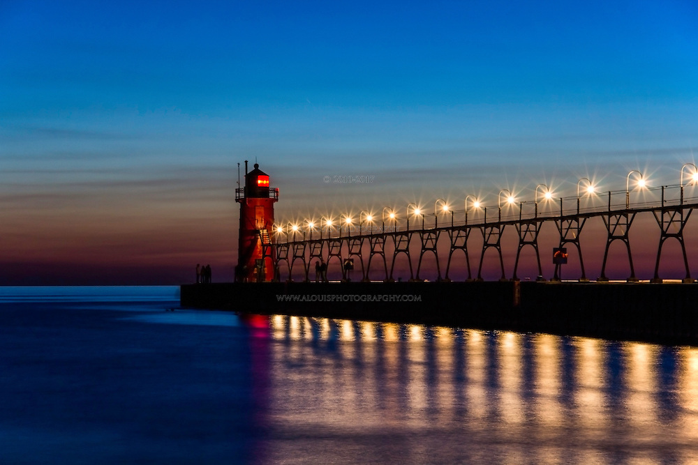 Long exposure, night scene of the south beach pier and lighthouse in South Haven, Michigan