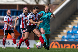 CHESTERFIELD, ENGLAND - Sunday, April 25, 2021: Liverpool's Amy Rodgers (R) is challenged by Sheffield United's Rhema Lord-Mears during the FA Women's Championship game between Sheffield United FC Women and Liverpool FC Women at the Technique Stadium. Liverpool won 1-0. (Pic by David Rawcliffe/Propaganda)