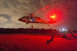 Apr 12, 2017 - Virginia Beach, Virginia, U.S. - Fast-Roping in the Red. Sailors fast-rope from an MH-60S Seahawk helicopter during training for rope-suspension techniques at Joint Expeditionary Base Fort Story in Virginia Beach, Va., April 12, 2017. The seaman are assigned to Explosive Ordnance Disposal Group 2. (Credit Image: ? Charles Oki/DoD via ZUMA Wire/ZUMAPRESS.com)