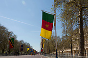 With the flag of Cameroon in the foreground, all the flags of Commonwealth Nations hang along the Mall, from Admiralty Arch to Buckingham Palace on the occasion of the bi-annual Commonwealth Heads of Government Meeting (CHOGM),  on 19th April 2018, in London, England.