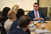 Houston ISD superintendent Dr. Terry Grier greets members of the Broad Foundation research team before a presentation, May 28, 2013.