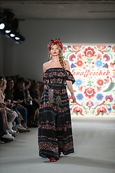 July 4, 2017 - Berlin, Berlin-Mitte, Germany - Berlin: From July 4 to July 7, 2017, the German and international fashion scene will again meet in Berlin-Mitte in the former department store Jahndorf. On the fashion shows and numerous events, the designers and labels present their spring / summer collections in 2018 and attract international trade publications as well as numerous Fashion enthusiasts in the German capital..The photo shows models with the LENA HOSCHEK collection on the catwalk. (Credit Image: © Pacific Press via ZUMA Wire)