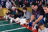 Fairfax, VA 1998/03/01 A Baby Derby.  A contest where infants try to go over a finish line while being encouraged by their parents.<br />Photo by Dennis Brack