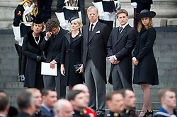 © London News Pictures.17/04/2013. London, UK.  L to R Carol Thatcher and her boyfriend Marco Grass, Sarah Thatcher, Mark Thatcher, Michael Thatcher and Amanda Thatcher watch the coffin of Margaret Thatcher leave St Paul's Cathedral in London following the funeral of former British Prime Minister Margaret Thatcher on April 17, 2013. Photo credit : Ben Cawthra/LNP