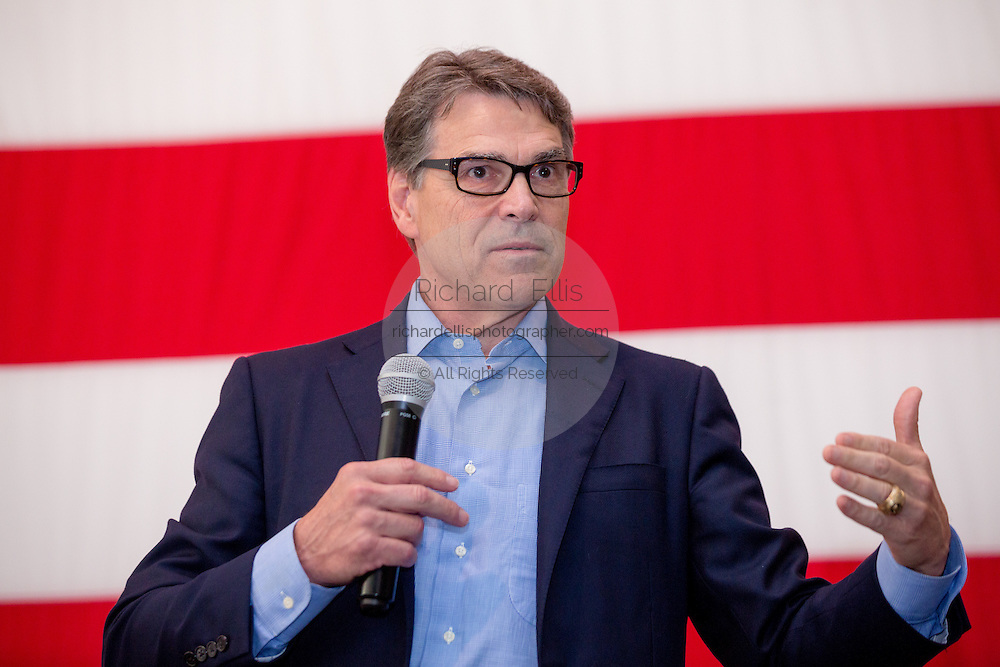 Former Texas Governor and GOP presidential hopeful Rick Perry addresses a crowd of supporters during a town hall event aboard the USS Yorktown in Mount Pleasant, South Carolina.