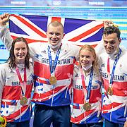 TOKYO, JAPAN - JULY 31:  The Great Britain team of  Kathleen Dawson, Adam Peaty, Anna Hopkin and James Guy after receiving their gold medals for victory in the mixed 4x100m relay during the Swimming Finals at the Tokyo Aquatic Centre at the Tokyo 2020 Summer Olympic Games on July 31, 2021 in Tokyo, Japan. (Photo by Tim Clayton/Corbis via Getty Images)