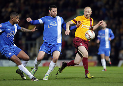 Peterborough United's Michael Bostwick in action with Bradford City's Gary Jones  - Photo mandatory by-line: Joe Dent/JMP - Mobile: 07966 386802 18/04/2014 - SPORT - FOOTBALL - Bradford - Valley Parade - Bradford City v Peterborough United - Sky Bet League One