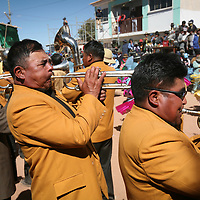 Trumpet players blow hard on their instrument in a brass band in a fiesta near Eucaliptus, Oruro Department, Bolivia