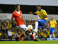 Photo: Ed Godden.<br /> Brazil v Wales. International Friendly. 05/09/2006.<br /> Lewin Nyatanga (L), challenges Brazil's Vagner Love.