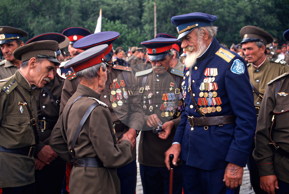 Russian Don Cossacks gather during a blessing at the Ascension Cathedral in Novocherkassk, Russia. The men are participating in the annual Cossack Festival gathering of units from around Russia.