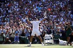 Novak Djokovic celebrates winning the Gentlemen's singles final on day thirteen of the Wimbledon Championships at the All England Lawn Tennis and Croquet Club, Wimbledon.