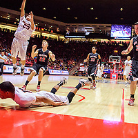 031215  Adron Gardner/Independent<br /> <br /> Gallup Bengal Cody Tabaha (13) slides down the lane as Bengal Sean Eskeets (23) attempts a layup on the Grants Pirates during a 5A New Mexico state basketball tournament semifinal at The Pit in Albuquerque Thursday.
