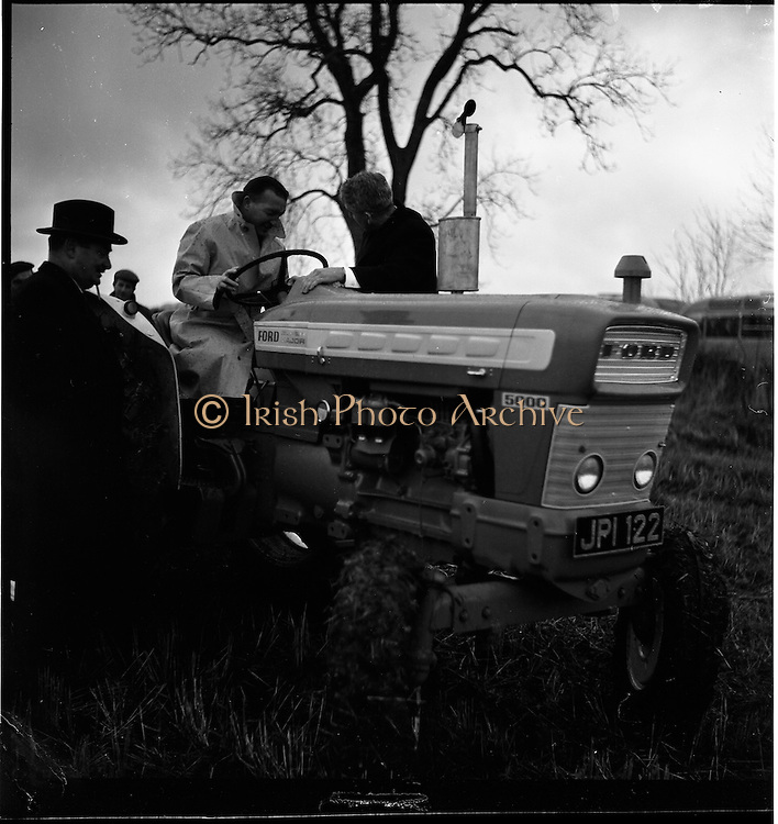 26/11/1964.11/26/1964.26 November 1964.Presentation of new Ford tractors at Lyons Estate Celbridge. Minister for Agriculture Charles Haughey trying out the new Ford Super Major 5000 watched by Minister for Lands Miceal O'Moran and G.F. McGovern, Tractor Manager, Tractor Operations Henry Ford and Sons Ltd. Cork.