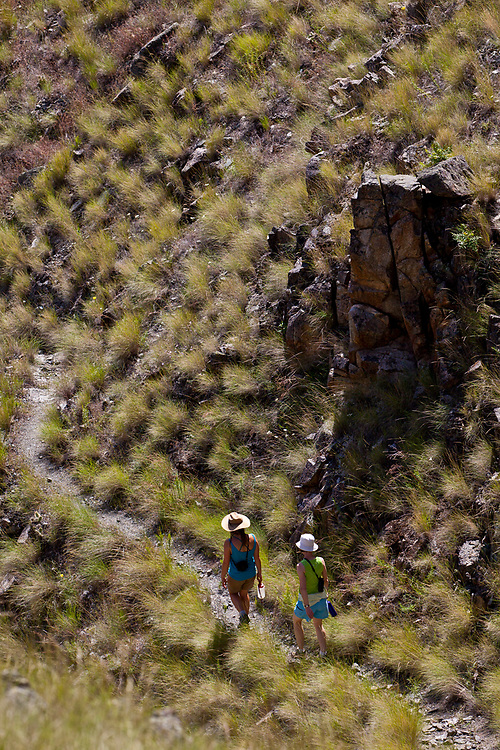 Two women walking along the Hells Canyon Trail on the Oregon side of the Snake River in springtime.<br /> Licensing and Open Edition Prints