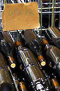bottles stored in wire cages grenache 2006 domaine giraud chateauneuf du pape rhone france