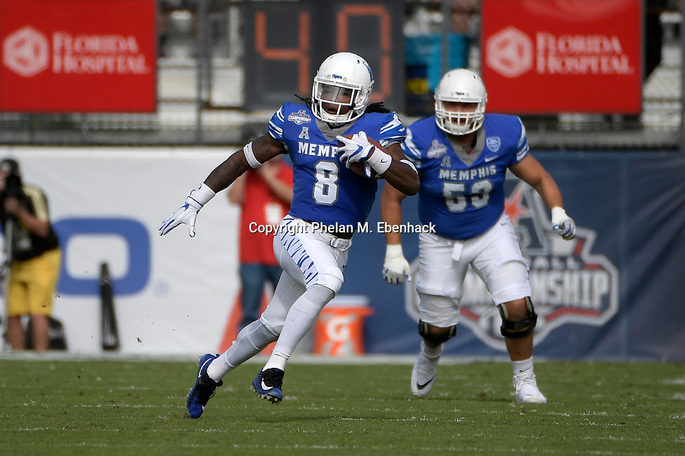 Memphis running back Darrell Henderson (8) rushes for yardage during the first half of the American Athletic Conference championship NCAA college football game against Central Florida Saturday, Dec. 2, 2017, in Orlando, Fla. (Photo by Phelan M. Ebenhack)