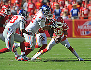 KANSAS CITY, MO - SEPTEMBER 29:  Strong Safety Eric Berry #29 of the Kansas City Chiefs recovers a fumble in front of offensive tackle Justin Pugh #72 of the New York Giants during the second half on September 29, 2013 at Arrowhead Stadium in Kansas City, Missouri.  (Photo by Peter Aiken/Getty Images) *** Local Caption *** Eric Berry;Justin Pugh