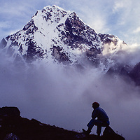 A mountaineer in base camp for an early mountaineering school for sherpas in the Khumbu region of Nepal, 1980.  Mt. Cholatse bkg.