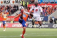 Fotball, <br /> 25.04.2011 , <br /> Tippeligaen  ,<br /> Eliteserien ,<br /> Aalesund FK - Sogndal 1-0 ,<br /> Color line stadion ,  <br /> Kjell Rune sallin - aalesund<br /> Ayhee aye elvis - sogndal<br /> Digitalsport